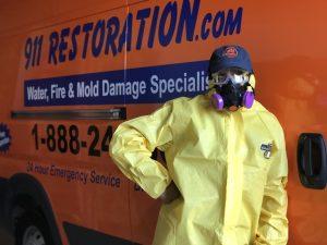 water damage restoration technician in front of van